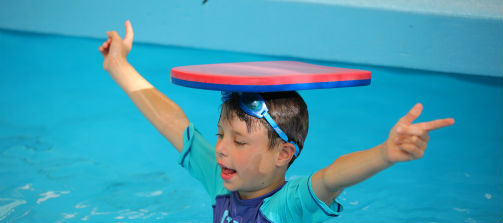 Boy with board on head